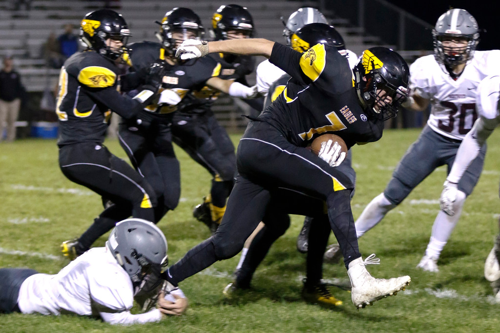 . Thompson Valley�s Jack Dyken (7) runs the ball toward the goal as Berthoud�s Austyn Binkly (4) tried to tackle him on Thursday, Sept. 28, 2017, at Patterson Field. (Photo by Lauren Cordova/Loveland Reporter-Herald)