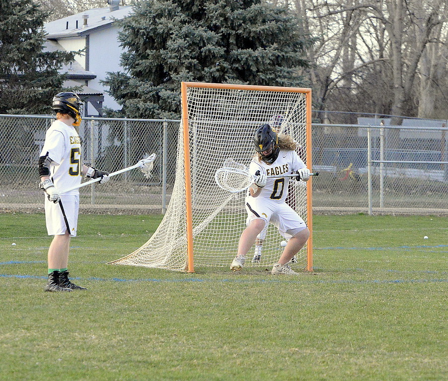 . Thompson Valley\'s Corbin Shilling comes up with the save against Cheyenne Mountain during Monday\'s matchup of 4A top-five teams. The Eagles won 13-12. (Mike Brohard/Loveland Reporter-Herald).