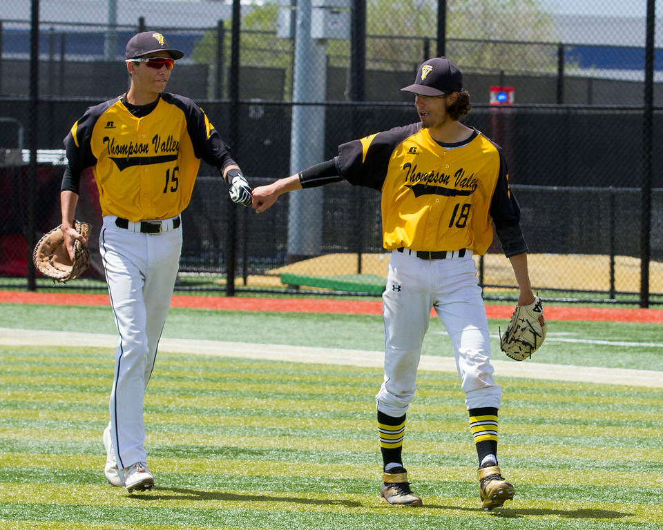 . Thompson Valley\'s Bailey Porter (18) bumps fists with first baseman Jayden Raabe (15) after getting out of a sticky situation against the Evergreen Cougars Friday morning May 26, 2017 at Metro State\'s Regency Athletic Complex during the 2017 CHSAA Baseball State Championships Final Four in Denver. The Eagles won the game, 12-9. (Michael Brian/For the Reporter-Herald)