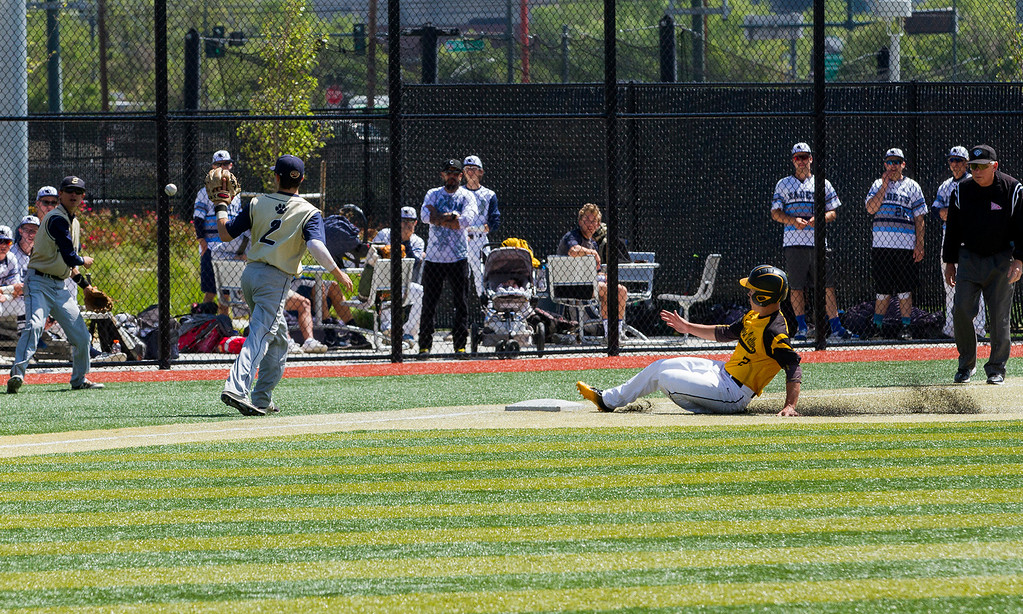 . Thompson Valley\'s Matt Berg (2) slides safely into third base after an errant Evergreen throw Friday morning May 26, 2017 at Metro State\'s Regency Athletic Complex during the 2017 CHSAA Baseball State Championships Final Four in Denver.  The Eagles beat the Cougars 12-9 to advance to Saturday play. (Michael Brian/For the Reporter-Herald)