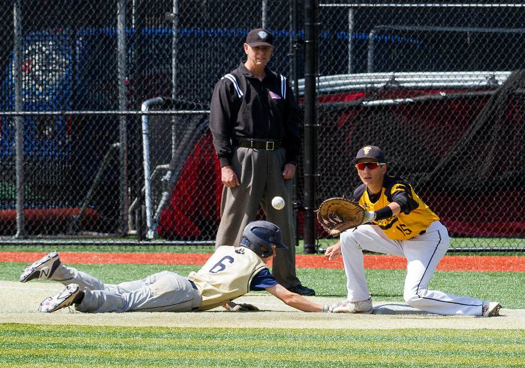 . Thompson Valley first baseman Jayden Raabe (15) reaches for the putout throw against Evergreen\'s Michael Kapner (6) Friday morning May 26, 2017 at Metro State\'s Regency Athletic Complex during the 2017 CHSAA Baseball State Championships Final Four in Denver.  The Eagles won the game, 12-9. (Michael Brian/For the Reporter-Herald)