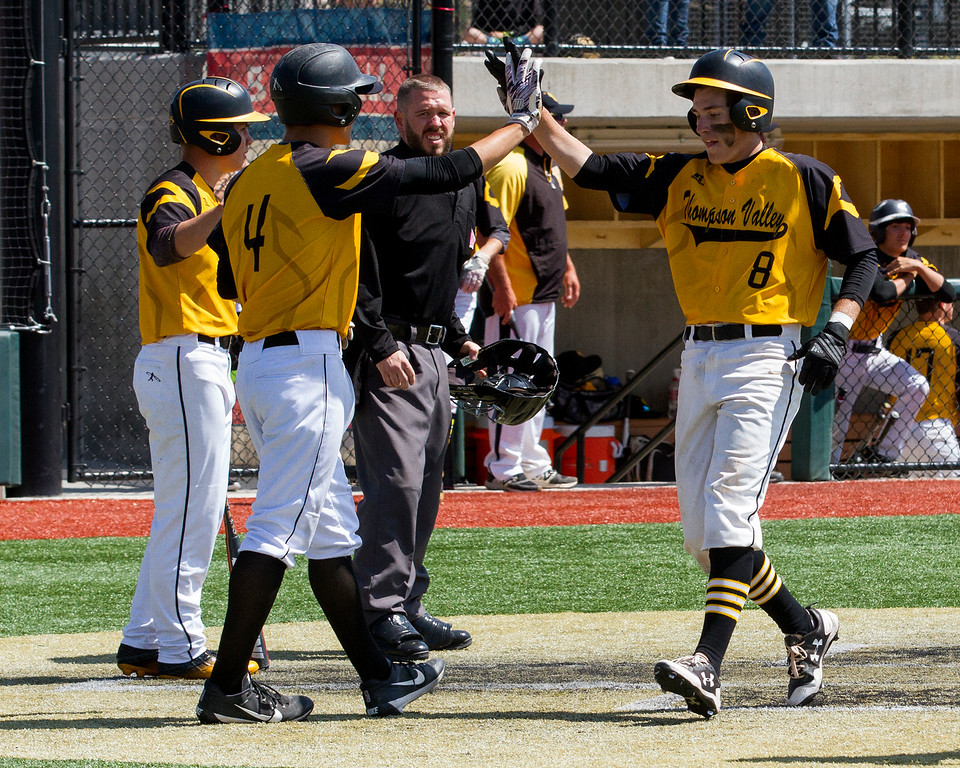 . Thompson Valley\'s Cameron Nellor (4) high-fives Austin Sobraske (8) as the two score runs against Evergreen Friday morning May 26, 2017 at Metro State\'s Regency Athletic Complex during the 2017 CHSAA Baseball State Championships Final Four in Denver.  The Eagles beat the Cougars, 12-9. (Michael Brian/For the Reporter-Herald)