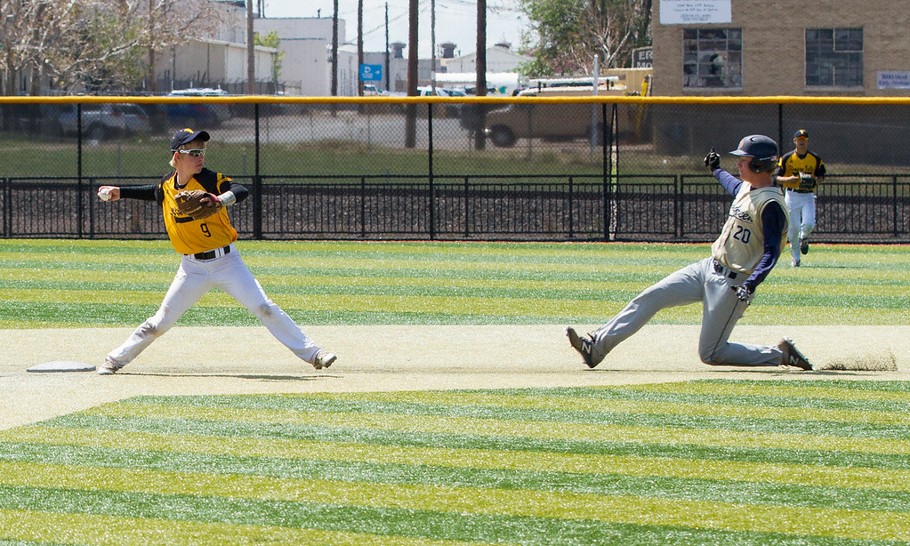 . After forcing Evergreen\'s Jack Patterson (20) out at second base, Thompson Valley\'s Kaleb White (9) tries for the double play Friday morning May 26, 2017 at Metro State\'s Regency Athletic Complex during the 2017 CHSAA Baseball State Championships Final Four in Denver.  The Eagles beat the Cougars, 12-9. (Michael Brian/For the Reporter-Herald)