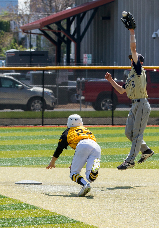 . Thompson Valley\'s Collin Derenburger (22) starts to slide into second base as Evergreen\'s Michael Kapner (6) leaps to make the catch Friday morning May 26, 2017 at Metro State\'s Regency Athletic Complex during the 2017 CHSAA Baseball State Championships Final Four in Denver.  The Eagles beat the Cougars, 12-9. (Michael Brian/For the Reporter-Herald)