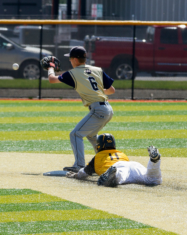 . Thompson Valley catcher Mike Berg (11) slides safely into second base as Evergreen\'s Michael Kapner (6) waits for the throw Friday morning May 26, 2017 at Metro State\'s Regency Athletic Complex during the 2017 CHSAA Baseball State Championships Final Four in Denver.  The Eagles beat the Cougars, 12-9. (Michael Brian/For the Reporter-Herald)