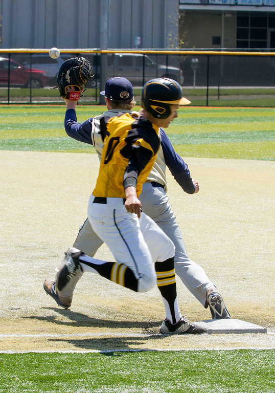 . Thompson Valley outfielder Tristan Schatz (20) just beats the throw safely to first base against Evergreen Friday morning May 26, 2017 at Metro State\'s Regency Athletic Complex during the 2017 CHSAA Baseball State Championships Final Four in Denver.  The Eagles won the game, beating the Cougars 12-9. (Michael Brian/For the Reporter-Herald)
