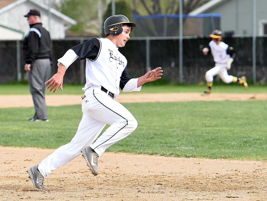 . Thompson Valley\'s #11 Mike Berg runs the bases to score during their game against Greeley Central Wednesday, April 26, 2017, at Constantz Field in Loveland. (Photo by Jenny Sparks/Loveland Reporter-Herald)
