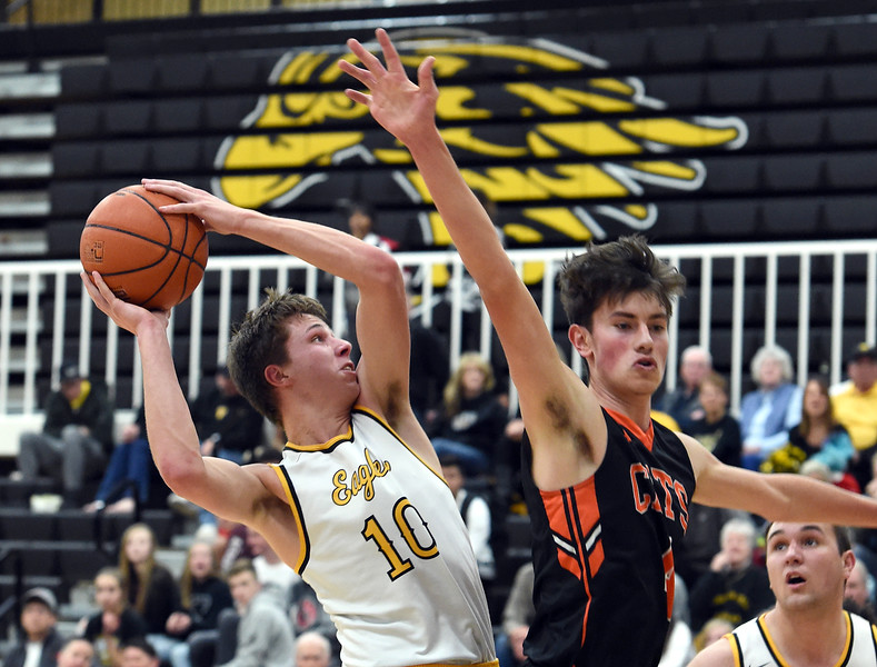 Thompson Valley's (10) Justin Wiersema goes up for a shot past Greeley Central's (4) Marcos Hernandez during their game Monday, Feb, 12, 2018, at Thompson Valley in Loveland. (Photo by Jenny Sparks/Loveland Reporter-Herald)