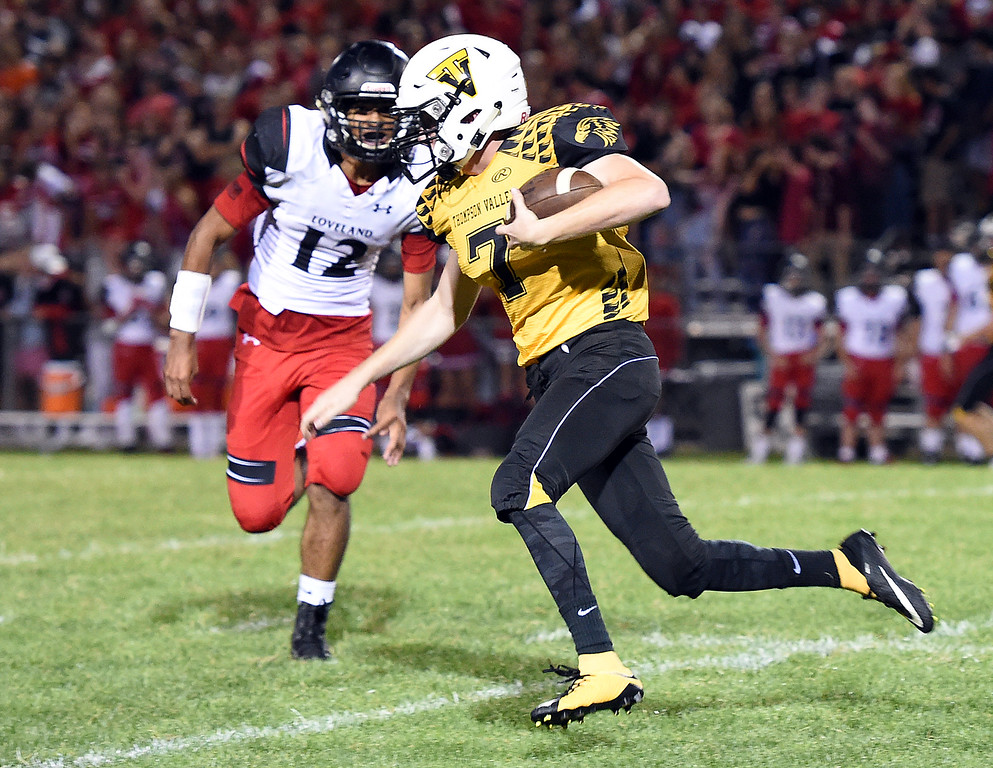 . Thompson Valley\'s (7) Jack Dyken takes the ball downfield during their game against Loveland on  Friday, Sept. 7, 2018, at Patterson Stadium in Loveland.  (Photo by Jenny Sparks/Loveland Reporter-Herald)