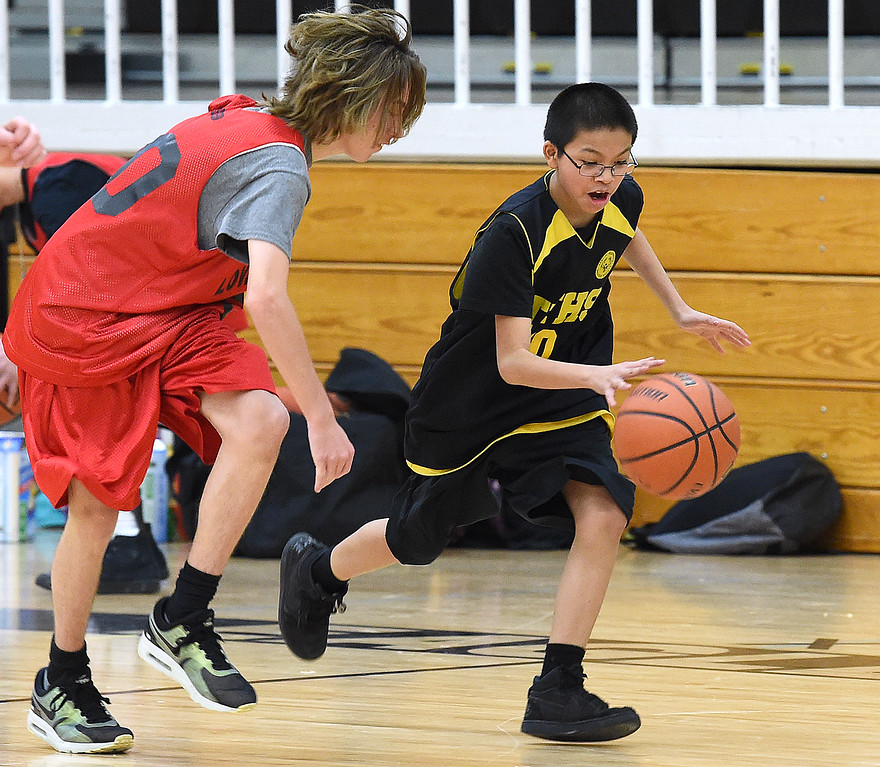 . Thompson Valley Unified\'s (10) Dom Maes takes the ball down court past Loveland Unified\'s (20) DestynValentine during their game on Thursday, Feb. 15, 2018, at Thompson Valley High School in Loveland. (Photo by Jenny Sparks/Loveland Reporter-Herald)