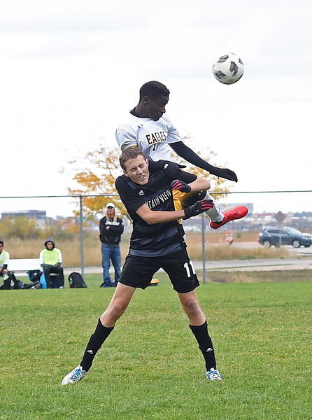 Thompson Valley's (14) Junio Lang and Mountain View's (11) Justin Condon hit a header during their game Tuesday, Oct. 9, 2018, at Mountain View High School in Loveland.  (Photo by Jenny Sparks/Loveland Reporter-Herald)