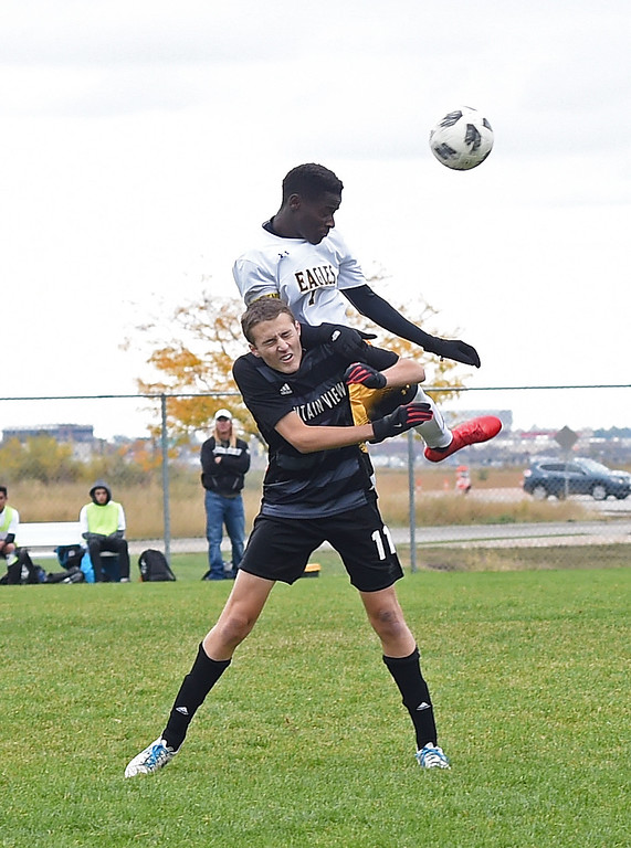. Thompson Valley\'s (14) Junio Lang and Mountain View\'s (11) Justin Condon hit a header during their game Tuesday, Oct. 9, 2018, at Mountain View High School in Loveland.  (Photo by Jenny Sparks/Loveland Reporter-Herald)