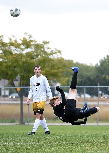 Mountain View's (10) Christian Soliz is up-ended as he kicks the ball behind him to try to score during their game against Thompson Valley on Tuesday, Oct. 9, 2018, at Mountain View High School in Loveland.  (Photo by Jenny Sparks/Loveland Reporter-Herald)