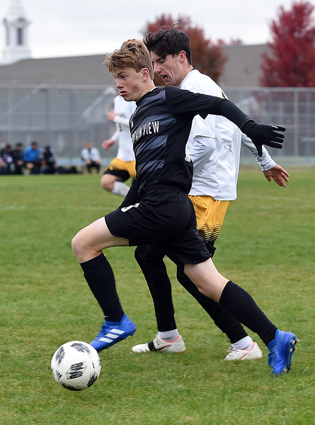 Mountain View's (10) Christian Soliz and  and Thompson Valley's (13) Ian Levin battle for control of the ball during their game Tuesday, Oct. 9, 2018, at Mountain View High School in Loveland.  (Photo by Jenny Sparks/Loveland Reporter-Herald)