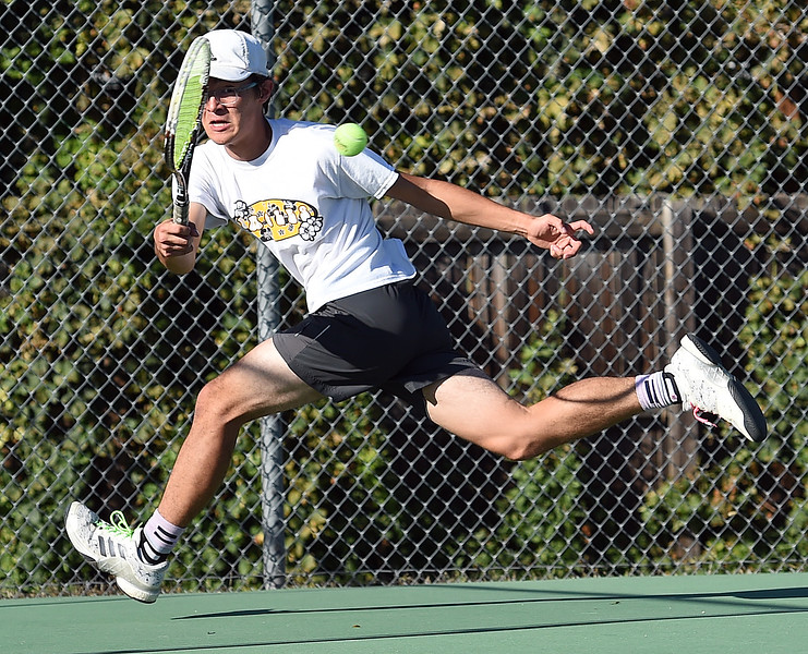 Thompson Valley's #2 singles player Evan Zhow hits the ball during his match against Mountain View's Cooper Frederick Thursday, Sept. 20, 2018, at Thompson Valley High School. (Photo by Jenny Sparks/Loveland Reporter-Herald)