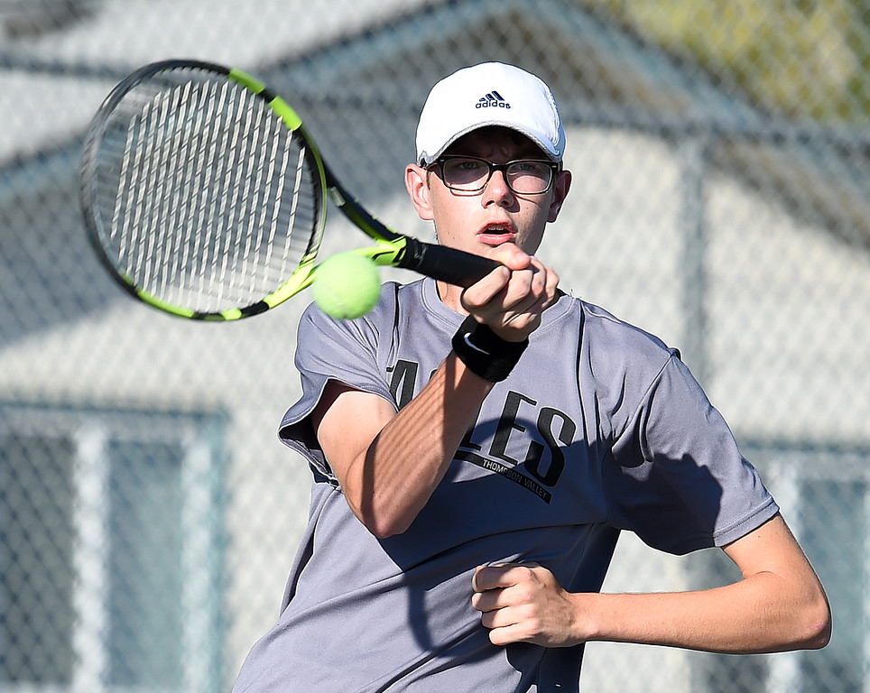 . Thompson Valley\'s #3 singles player Jake Tucker hits the ball during his match against Mountain View\'s Cleveland Odd Thursday, Sept. 20, 2018, at Thompson Valley High School. (Photo by Jenny Sparks/Loveland Reporter-Herald)
