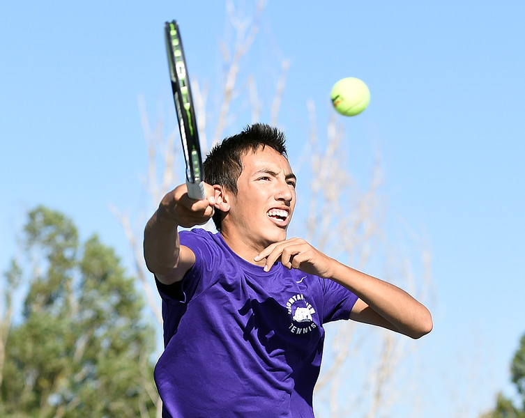 Mountain View's #1 singles player Erik Cooper hits the ball during his match against Thompson Valley's Evan Zhow Thursday, Sept. 20, 2018, at Thompson Valley High School. (Photo by Jenny Sparks/Loveland Reporter-Herald)