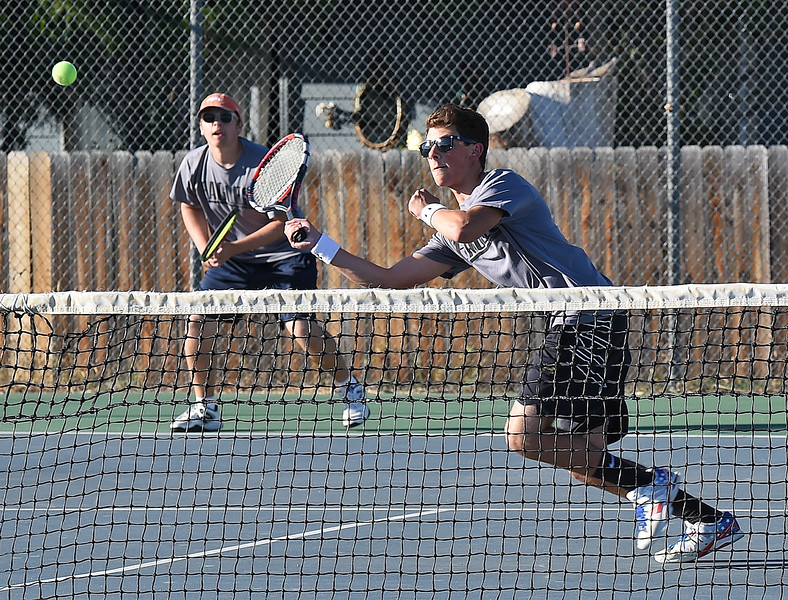 Thompson Valley's #1 doubles players Colin Davies, front, and Lincoln Solt play during their match against Mountain View's Hunter Todd and Jackson Van Heel Thursday, Sept. 20, 2018, at Thompson Valley High School. (Photo by Jenny Sparks/Loveland Reporter-Herald)