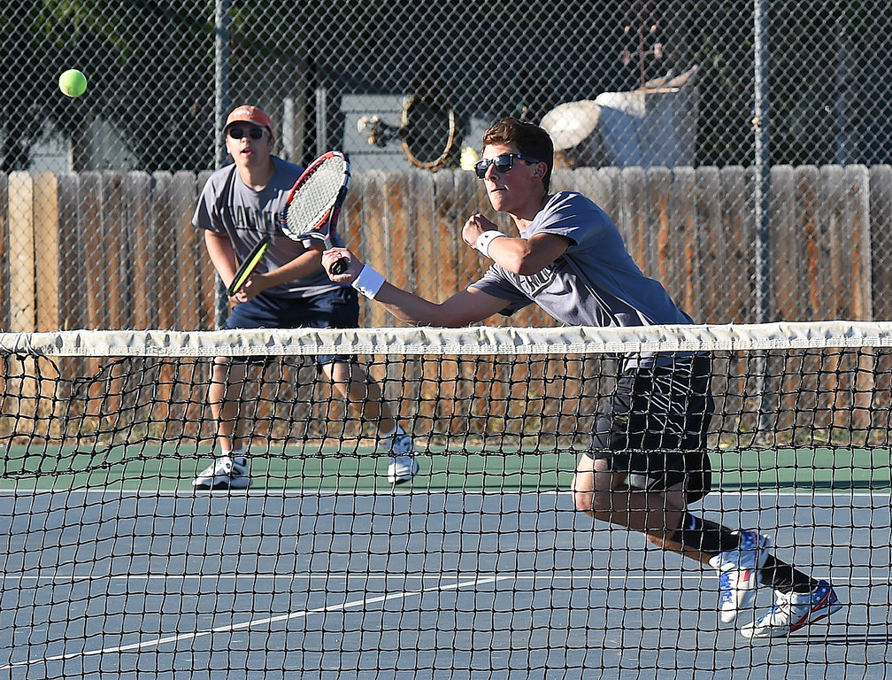 . Thompson Valley\'s #1 doubles players Colin Davies, front, and Lincoln Solt play during their match against Mountain View\'s Hunter Todd and Jackson Van Heel Thursday, Sept. 20, 2018, at Thompson Valley High School. (Photo by Jenny Sparks/Loveland Reporter-Herald)