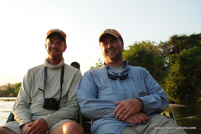 Jeff Currier and Jim Klug enjoying the boat ride back to camp after a long day of fishing and filming