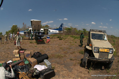 Arrived in the bush after leaving Dar Es Salaam. Unloading our gear and loading up gear.