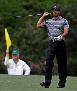 Tiger Woods walks down the second fairway after teeing off during the first round of the Masters golf tournament in Augusta, Ga., Thursday, April 8, 2010. (AP Photo/Morry Gash)