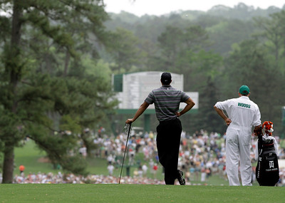 Tiger Woods waits to play on the second fairway with caddie Steve Williams during the first round of the Masters golf tournament in Augusta, Ga., Thursday, April 8, 2010. (AP Photo/Rob Carr)