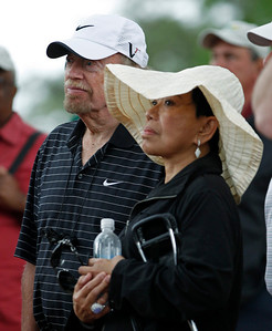 Tiger Woods' mother, Kultida Woods, and Nike co-founder Phil Knight watch the first round of the Masters golf tournament in Augusta, Ga., Thursday, April 8, 2010. (AP Photo/Morry Gash)
