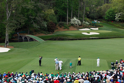 Tiger Woods tees off at the 12th hole during the first round of the Masters golf tournament in Augusta, Ga., Thursday, April 8, 2010. Far right is Y.E. Yang of Korea. (AP Photo/Morry Gash)