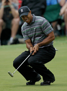 Tiger Woods reacts to missing a birdie putt on the 16th green during the first round of the Masters golf tournament in Augusta, Ga., Thursday, April 8, 2010. (AP Photo/David J. Phillip)