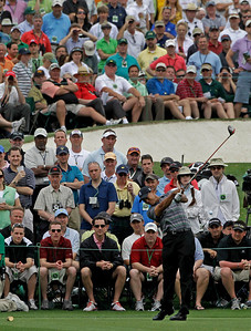 Spectators watch as Tiger Woods drives off the third tee during the first round of the Masters golf tournament in Augusta, Ga., Thursday, April 8, 2010. (AP Photo/Morry Gash)