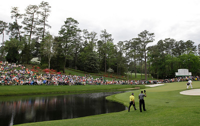 Tiger Woods, right, walks down the 16th fairway with K.J. Choi of South Korea during the first round of the Masters golf tournament in Augusta, Ga., Thursday, April 8, 2010. (AP Photo/David J. Phillip)
