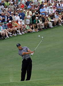 Tiger Woods chips to the second green during the first round of the Masters golf tournament in Augusta, Ga., Thursday, April 8, 2010. (AP Photo/David J. Phillip)