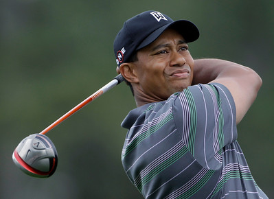 Tiger Woods watches his tee shot on the first hole during the first round of the Masters golf tournament in Augusta, Ga., Thursday, April 8, 2010. (AP Photo/Morry Gash)