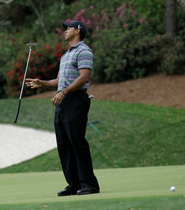 Tiger Woods flips his putter after missing an eagle putt on the 13th green during the first round of the Masters golf tournament in Augusta, Ga., Thursday, April 8, 2010. (AP Photo/David J. Phillip)