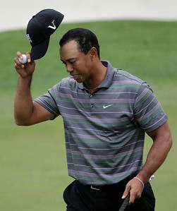 Tiger Woods tips his cap on the 18th green following his first round of the Masters golf tournament in Augusta, Ga., Thursday, April 8, 2010. (AP Photo/Morry Gash)