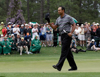 Tiger Woods tips his cap on the 18th hole after finishing his first round of the Masters golf tournament in Augusta, Ga., Thursday, April 8, 2010. (AP Photo/David J. Phillip)
