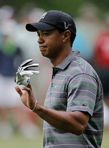 Tiger Woods waves to spectators as he walks down the second fairway during the first round of the Masters golf tournament in Augusta, Ga., Thursday, April 8, 2010. (AP Photo/Morry Gash)