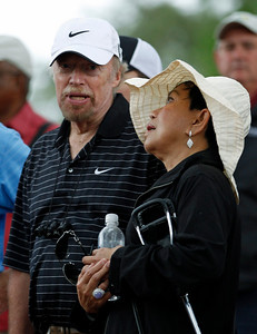 Tiger Woods' mother, Kultida Woods, chats with Nike co-founder Phil Knight during the first round of the Masters golf tournament in Augusta, Ga., Thursday, April 8, 2010. (AP Photo/Morry Gash)