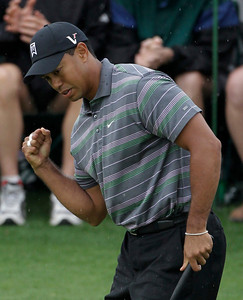 Tiger Woods pumps his fist after his birdie putt on the ninth green during the first round of the Masters golf tournament in Augusta, Ga., Thursday, April 8, 2010. (AP Photo/Morry Gash)
