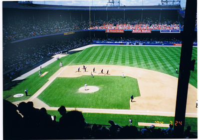 "The grounds crew.  As you can see it is rather dark and gloomy in the stands (you should have seen the bathrooms!)  It is said that when the Hall-of-Famer Al Kaline first arrived here in the late 50's his first impression seeing it from the outside was, ""it looks  like a Battleship!"