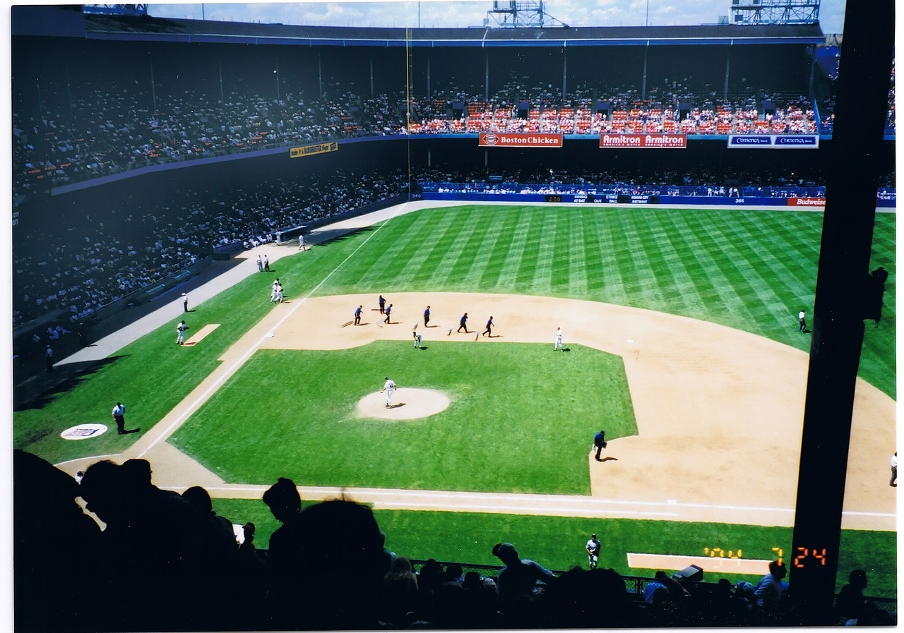 """The grounds crew.  As you can see it is rather dark and gloomy in the stands (you should have seen the bathrooms!)  It is said that when the Hall-of-Famer Al Kaline first arrived here in the late 50's his first impression seeing it from the outside was, """"it looks  like a Battleship!"""