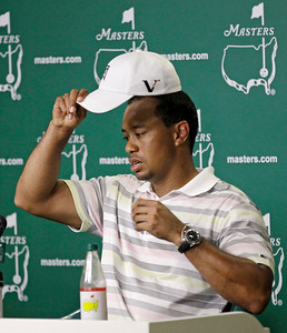 Tiger Woods takes off his cap before his press conference at the Masters golf tournament in Augusta, Ga., Monday, April 5, 2010. The tournament begins Thursday, April, 8. (AP Photo/David J. Phillip)