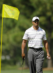Tiger Woods walks off a green during a practice round for the Masters golf tournament in Augusta, Ga., Monday, April 5, 2010. The tournament begins Thursday, April, 8. (AP Photo/David J. Phillip)