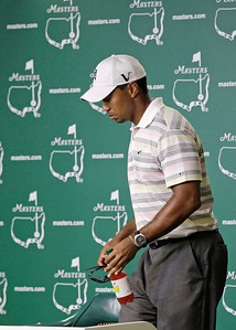 Tiger Woods arrives for his press conference at the Masters golf tournament in Augusta, Ga., Monday, April 5, 2010. The tournament begins Thursday, April, 8. (AP Photo/David J. Phillip)