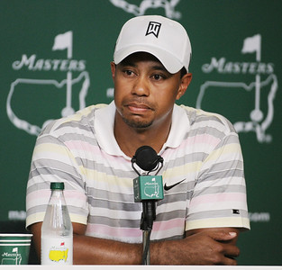 Tiger Woods listens to a question during his news conference at the Masters golf tournament in Augusta, Ga., Monday, April 5, 2010. The tournament begins Thursday, April, 8. (AP Photo/Harry How, Pool)