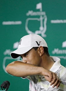 Tiger Woods wipes his face during a press conference at the Masters golf tournament in Augusta, Ga., Monday, April 5, 2010. The tournament begins Thursday, April, 8. (AP Photo/David J. Phillip)