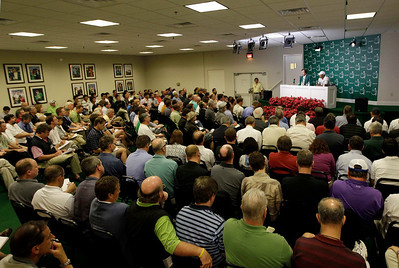 Tiger Woods sits next Craig Heathley, left, during a press conference at the Masters golf tournament in Augusta, Ga., Monday, April 5, 2010. The tournament begins Thursday, April, 8. (AP Photo/David J. Phillip)