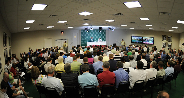 Tiger Woods, right, speaks during a press conference at the Masters golf tournament in Augusta, Ga., Monday, April 5, 2010. The tournament begins Thursday, April, 8. At his left is Craig Heathley. (AP Photo/Harry How, Pool)