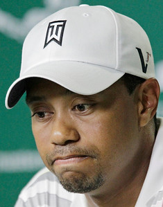 Tiger Woods reflects on a question during a news conference at the Masters golf tournament in Augusta, Ga., Monday, April 5, 2010. The tournament begins Thursday, April, 8. (AP Photo/David J. Phillip)